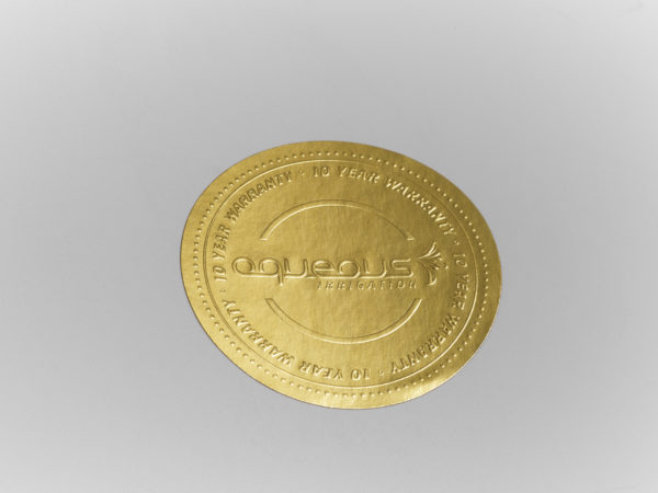 Embossed gold labels